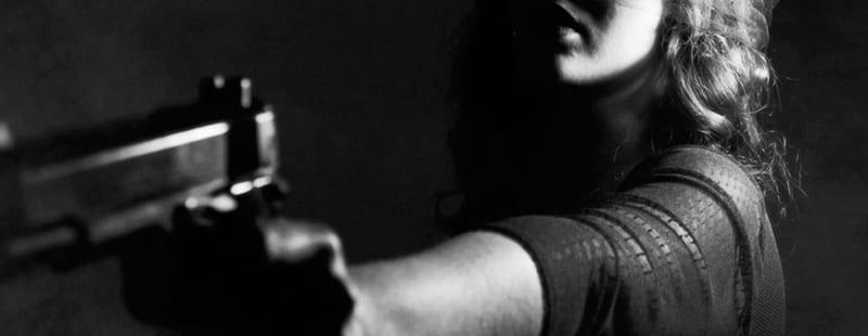woman pointing gun | Ocala Assault & Battery Lawyers
