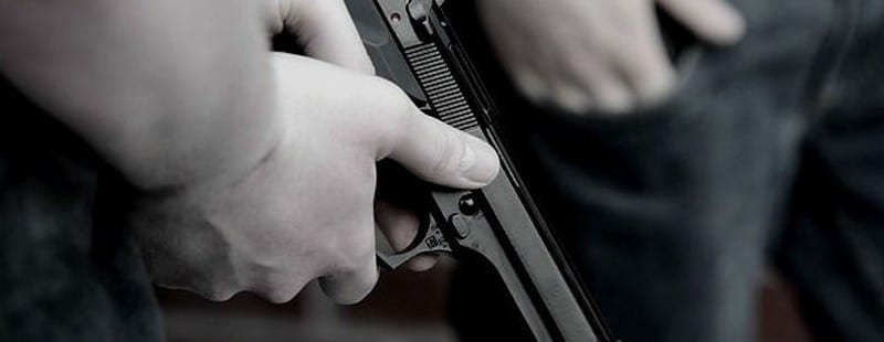 Hands Holding Gun | Ocala & Gainesville Criminal Defense Attorneys Defend Armed Robbery and all gun charges.