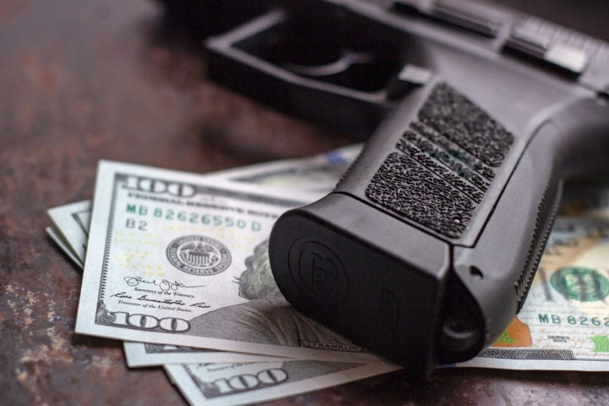 Cash and Gun from Armed Robbery Crime