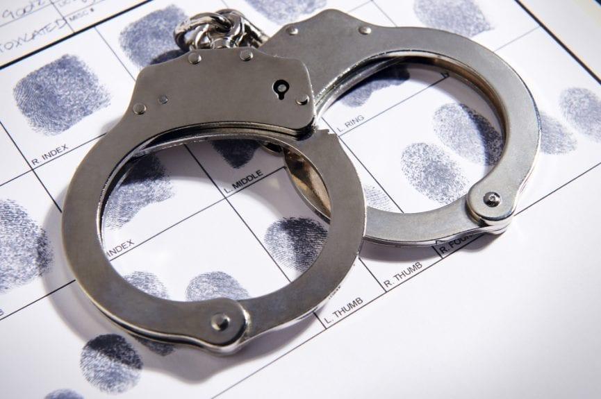 criminal record: handcuff and fingerprints