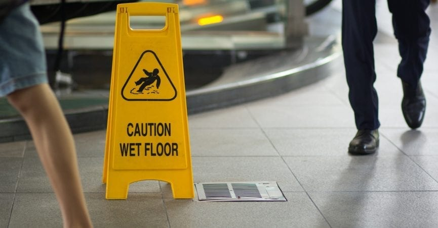 Caution wet floor sign, slip and fall injury